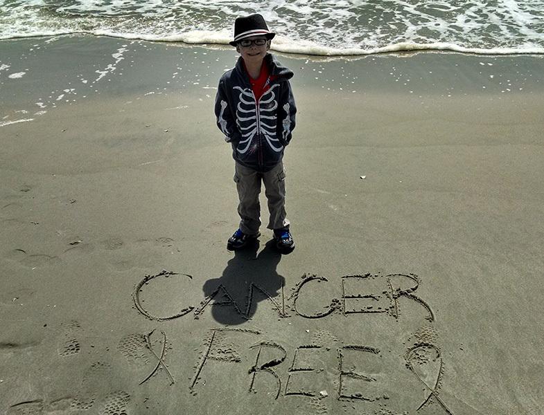 Austin standing on beach