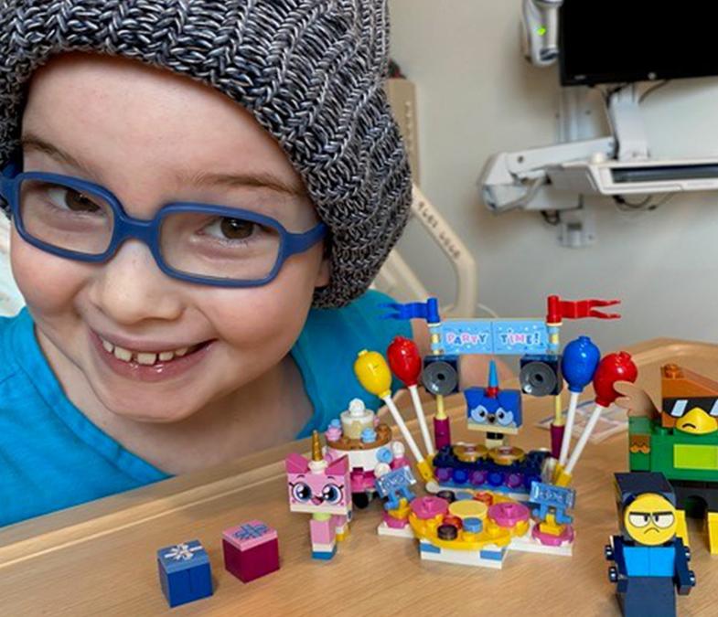 girl playing lego