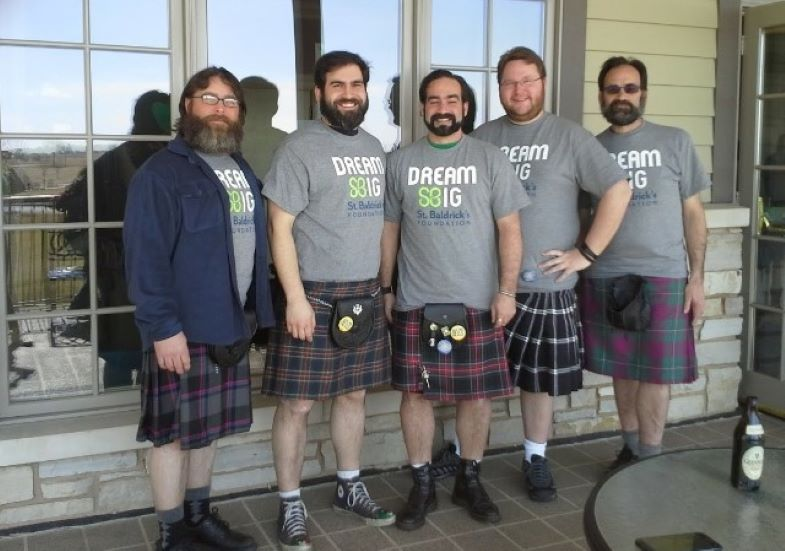 Group shot of men in kilts