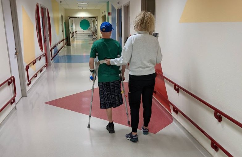 Honored Kid Michael G on crutches in the hospital.
