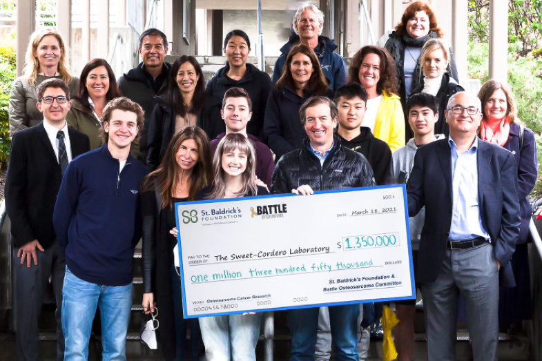Battle Osteosarcoma volunteers holding a check for $1,350,000