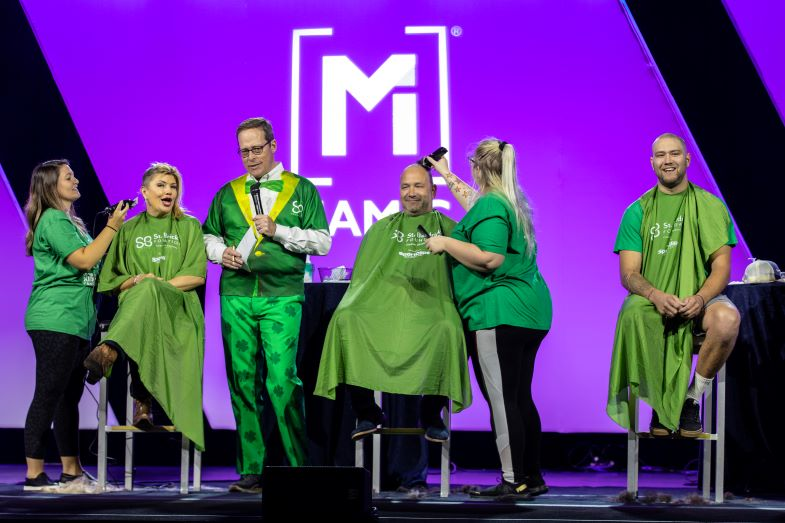 The Linkous Family shaves their head at the 126th Annual NAMIC Convention