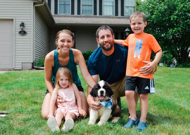Hudson with his mom, dad, sister, and dog.